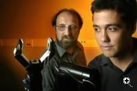 Miguel Nicolelis, and Jose Carmena  with robot arm (Credit: Duke University)