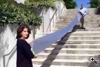 Nick Sheridon and Fereshteh Lesani show off the first roll of Gyricon E-PAPER produced by 3M partners. (Credit: Xerox).