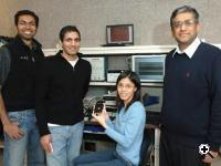 From left, electrical engineering graduate students Yogesh Ramadass, Naveen Verma, and Joyce Kwong, along with Professor Anantha Chandrakasan. This team has developed a microchip that can be up to 10 times more energy-efficient than present technology (Credit: MIT)