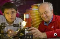 SEAS Researchers Nanfang Yu (left) and Federico Capasso (right) with the new laser (Credit: Harvard University)