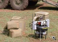 The Flying Beer Keg next to the backpacks designed to carry it (Credit: US Army Future Combat Systems)