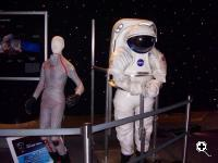 MIT's BioSuit spacesuit displayed next to a traditional Apollo spacesuit