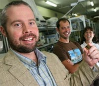 Professor Ben Eggleton (foreground) holding a photonic chip with (from left) student Neil Baker and researcher Snjezana Tomljenovic-Hanic. (Credit: University of Sydney)