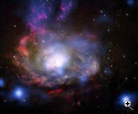 This composite image shows the central regions of the nearby Circinus galaxy, located about 12 million light years away. Data from NASA's Chandra X-ray Observatory is shown in blue and data from the Hubble Space Telescope is shown in yellow (