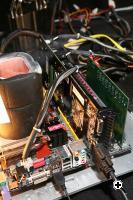 The Dragon Pot filled with liquid nitrogen during the first cooling phase next to a special diagnostic board that sits on a PCI-E slot next to the ATI Radeon(TM) 4870 X2 graphics card all on the DFI