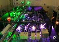 Physicists used lasers to elicit a previously undiscovered natural feedback reaction that stabilizes quantum dots' magnetic field (Credit: University of Michigan)