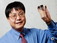 Professor Jian-Ku Shang holding a vial of the photocatalyst disinfectant. (Source: University of Illinois at Urbana-Champaign/L. Brian Stauffer)