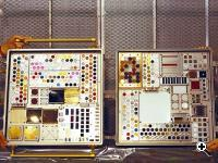 Two passive experiment containers containing MISSE project components for testing outside the International Space Station. (Source: NASA)