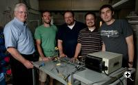 Professor Brian Cantwell, graduate student Yaniv Scherson, Professor Craig Criddle, and graduate students George Wells and Koshlan Mayer-Blackwell in the Criddle lab with the nitrous oxide decomposition cell.(Source: Standford University)