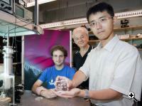 Researchers Mikhail A. Kats, Federico Capasso, and Nanfang Yu show their ability to sculpt an artificial optical structure on the facet of a laser. (Source: Eliza Grinnel/ School of Engineering and Applied Sciences)