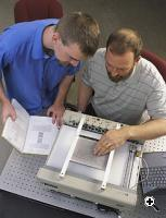Researchers John Roberts (right) and Oliver Slattery (left) using to depict the NIST logo (Credit: Robert Rathe/NIST)